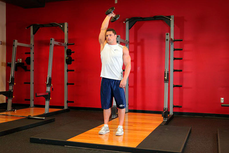Stretching up with dumbbells