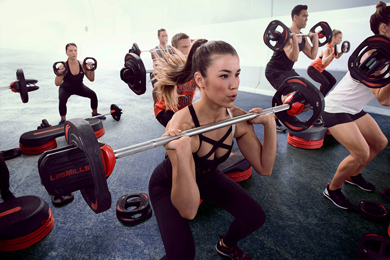 girl engaged in body pump